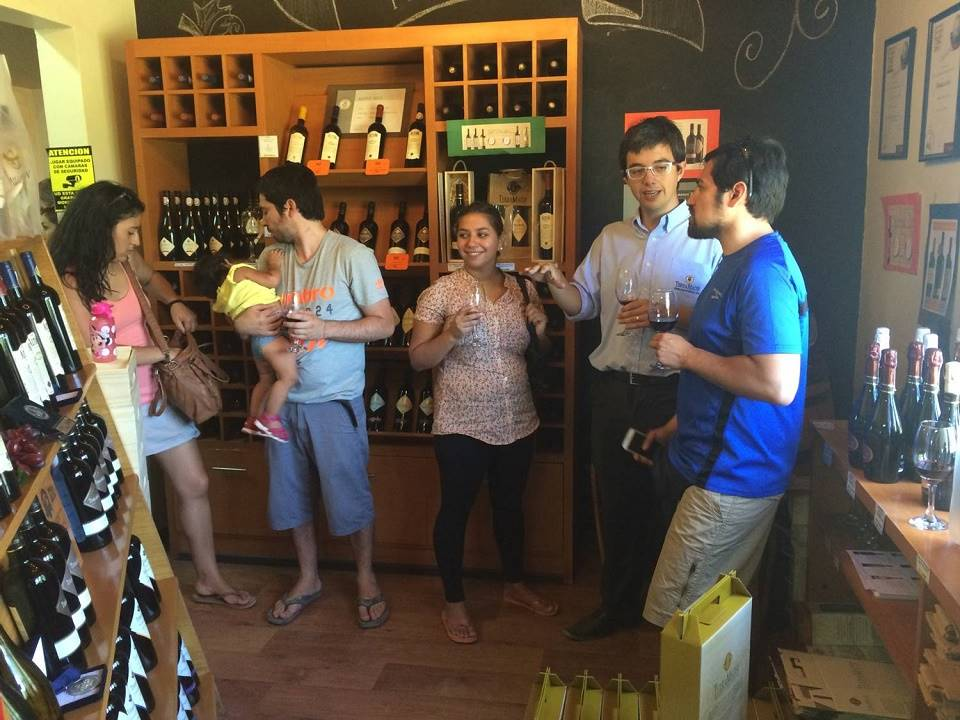 Family tasting wine in Terramater