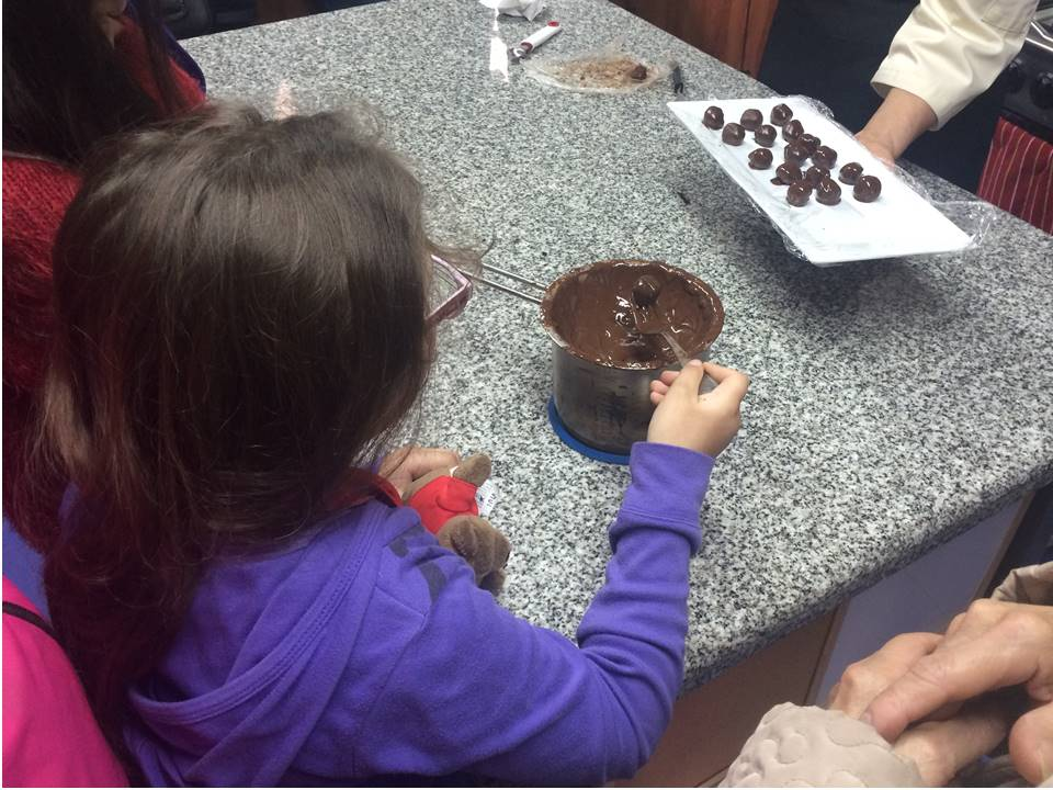 Child making chocolates